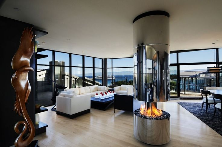 Interior Modern Apartment Design: Silver Fire Cage Modern Apartment Design With Metal Center Contemporary Fireplace Mix White Sofa Set Also Wooden Varnished Craft Artwork On Soft Color Laminate Flooring