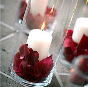 Create your own centerpieces with candles and rose petals. Perfect for a romantic and classic wedding.