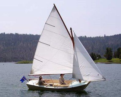 This is a San Francisco Pelican sailboat. We had one like this one, and sailed it on Lake Tahoe. It is called a gaff rigged cat boat. Didn't use it much, like most boats. Sold it.