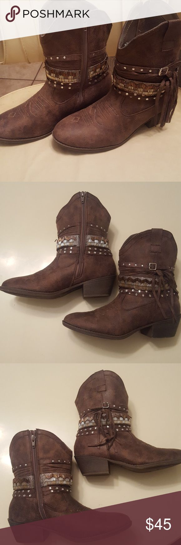 Nwt Brown Rhinestone Buckle Boots Size 9 These are nwt ankle boots, color is a rich brown on the top of foot embroidered. Theyre size 9 in women, bought from Justice for girls because I love their shoes! But I havent worn, have too many pairs. These zip up on the inside of your ankles. They are beautiful, but not too girly at same time. They have rhinestones, silver round studs, gold silver & rose gold tri-beated have strap that wraps around ankle three straps around these with rhinestones…