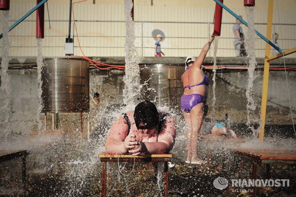 Water massage exercises on a beach in Sochi's Adler District.
