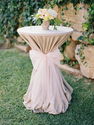 A tall table tied with a tulle bow: http://www.stylemepretty.com/2014/10/07/glamorous-floral-wedding-in-marbella-spain/ | Photography: Sandoval Studios - http://www.sandovalstudios.com/