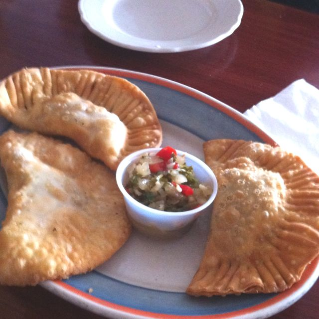 Cuban food- empanadas. Empanadas are made by folding dough or bread around stuffing, which usually consists of a variety of meat, cheese, vegetables or fruits, among others.