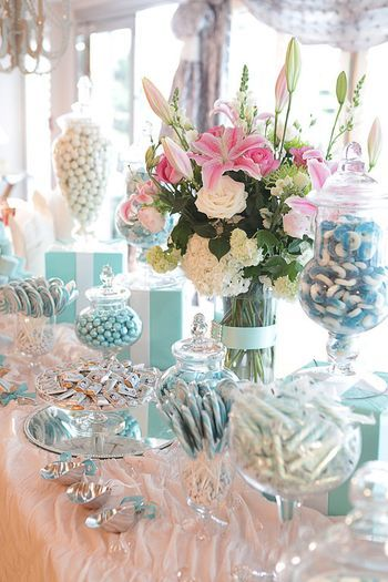 """Some floral inspiration if your spring wedding colors are white and pink. This one features Stargazer lilies, pink and white roses, white hydrangea and we think some white snapdragons and green mums are also in there. This is from a """"Breakfast at Tiffanys"""" themed party - that's why you see all the Tiffany blue on the table!"""