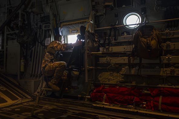 Staff Sgt. Korey King, a 17th Special Operations Squadron loadmaster, looks out the window of an MC-130J during exercise Keen Sword 17, Nov. 7, 2016, near Okinawa, Japan. Exercises like Keen Sword 17 demonstrate the joint capabilities of the U.S and Japan. (U.S. Air Force photo/Senior Airman Stephen G. Eigel)