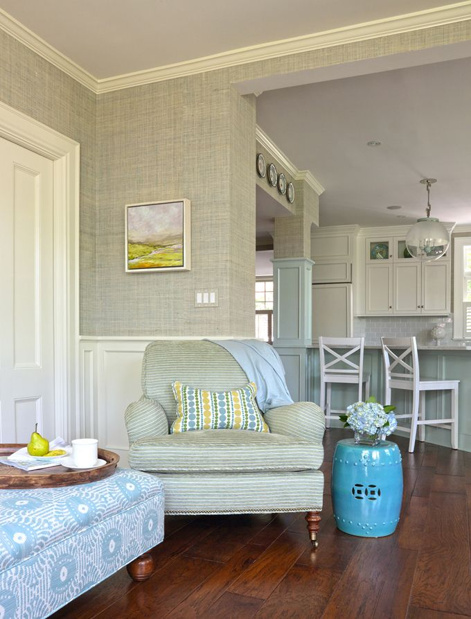 Love all the texture of the grass cloth,the chair, the colored cabinets Fun decorating style nice place to call home!