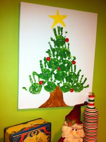 would be cute to make 1 big tree on a wall at work with all the kids handprints