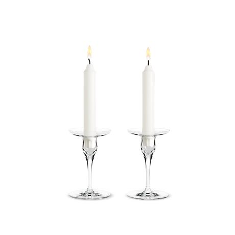 There are many ways of welcoming guests. Candles and a beautiful table is one of them, and Peter Svarrer's and Holmegaard's designer candle holder from the Cabernet range is an elegant solution.  #holmegaard #cabernet #candleholders