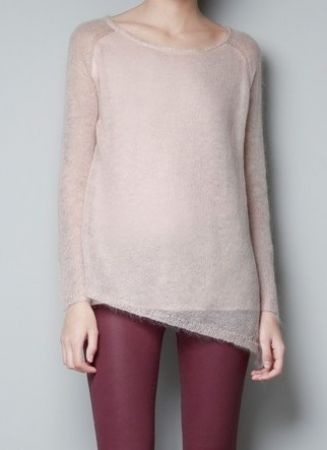 pink pullover sweater.and red pants
