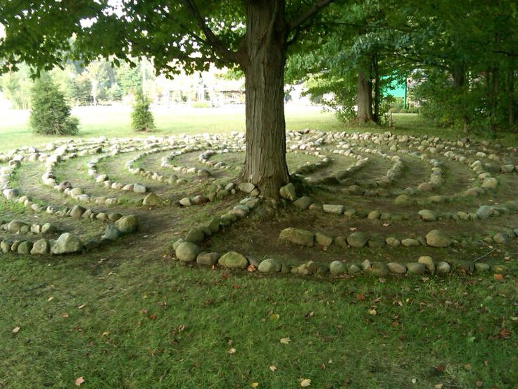 """""""The labyrinth at the Chautauqua Institution lies partly in shade and partly in sun. Photo from the Chautauqua Institution.""""    The tree almost appears to draw the labyrinth up our of the earth. A wonderful design touch."""