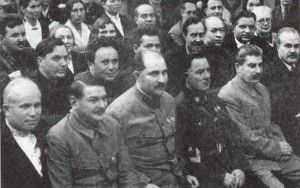 In the front row, L. to R.: Kruschev, Zhdanov, Kaganovitch, Vorochilov, Stalin, Molotov.