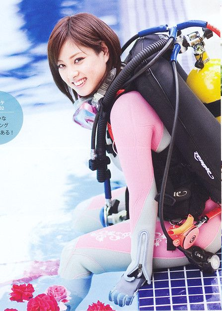 Asian girl in pink and white wetsuit