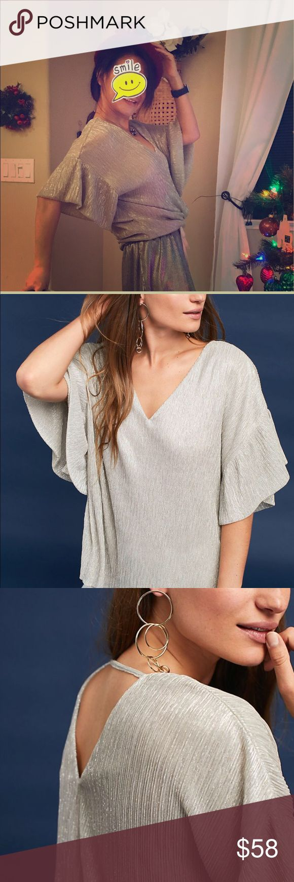 """Anthropologie Women's Ruffled Metallic Top Ruffled sleeves and a subtle shine give this chic tee a contemporary, yet feminine edge.  Polyester, metallic thread Ruffled sleeves Pullover styling Hand wash Imported Dimensions  Regular: 27""""L Petite: 25.25""""L Anthropologie Tops Blouses"""