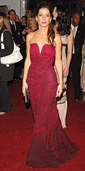 """Sandra Bullock's Style Evolution   QUEEN OF FASHION     She selected a strapless maroon Alberta Ferretti gown, which was tailored perfectly to her body, at the 2007 """"Poiret: King of Fashion"""" Met Gala in 2007."""