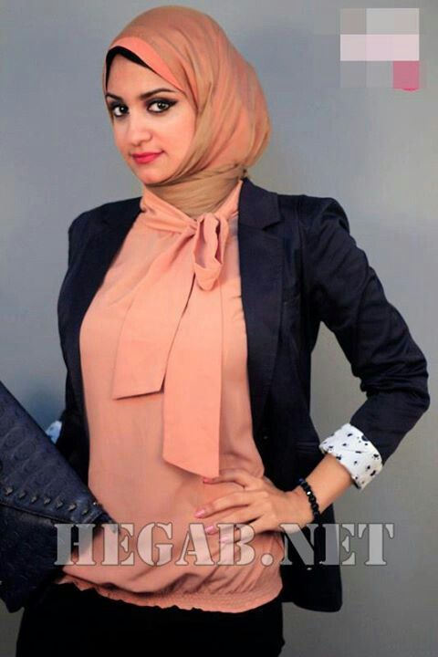 Business Casual: Here's another example of business casual -  dark jacket and slacks/skirt with a complementary bright blouse.