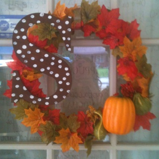 Dollar Store Wreath Covered With Fall Leaves And Pumpkins The Letter Came From A Craft Painted It Hot Glued On