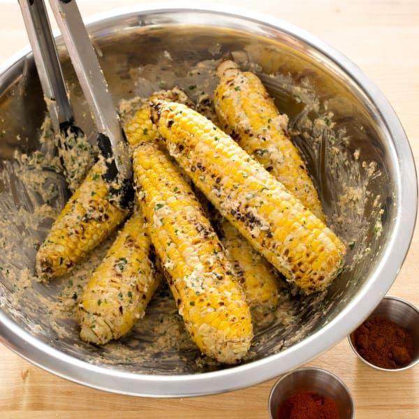 Mexican street vendors add kick to grilled corn by slathering it with a creamy, spicy sauce. Could we deliver authentic south-of-the-border flavor in our own backyard?
