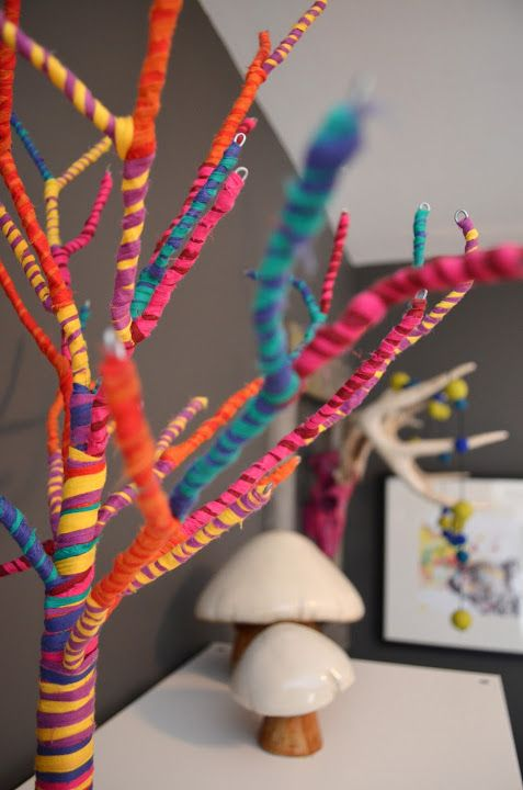 Yarn Bombed twigs and branches. I would go with one solid ...