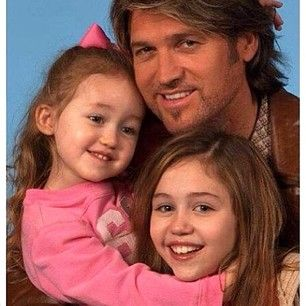 Miley Cyrus posted this super-cute photo of herself with her dad, Billy Ray, and little sister, Noah. | 13 Celebrity
