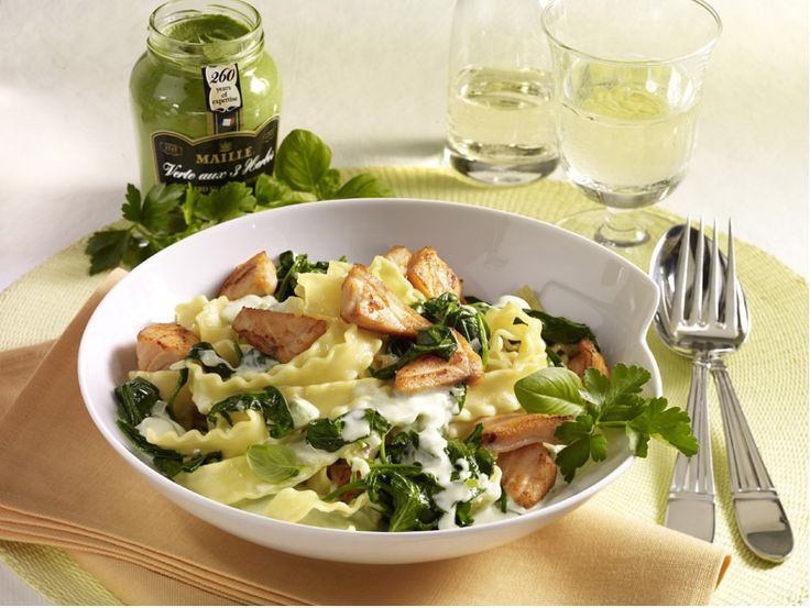 Pasta gets a hit of freshness from pan-seared salmon and Maille Fines Herbes Mustard.
