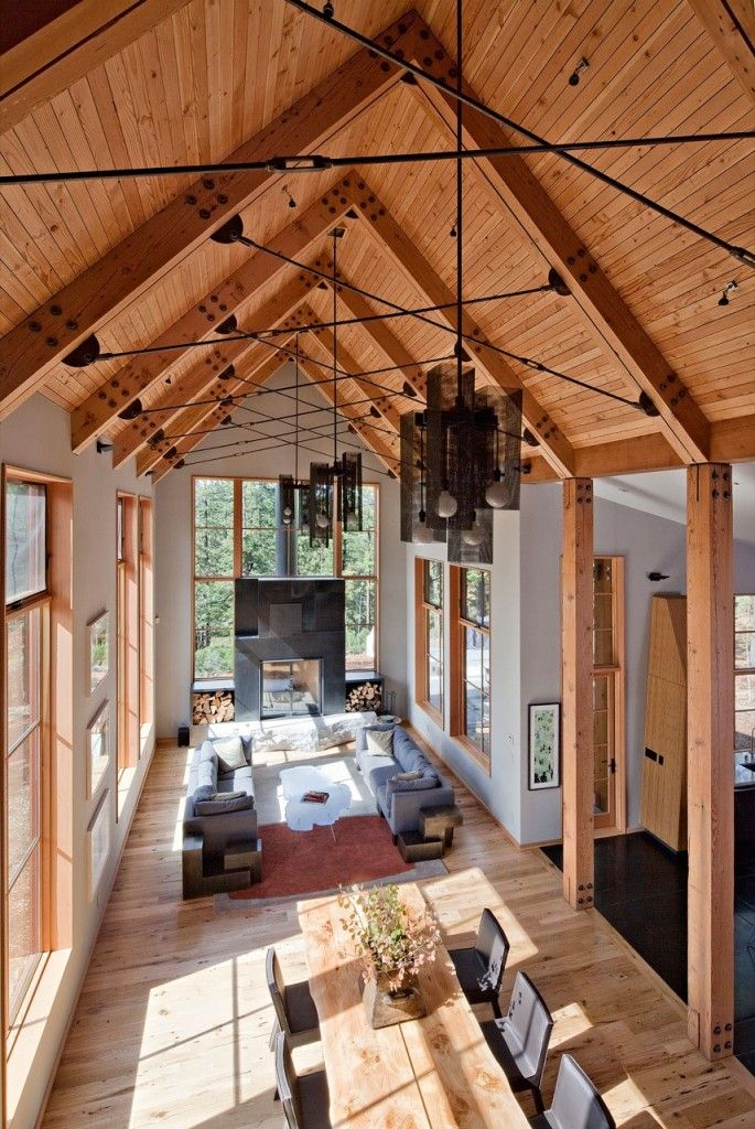 Lake house. love the big table for everyone to gather, beams, vaulted ceiling