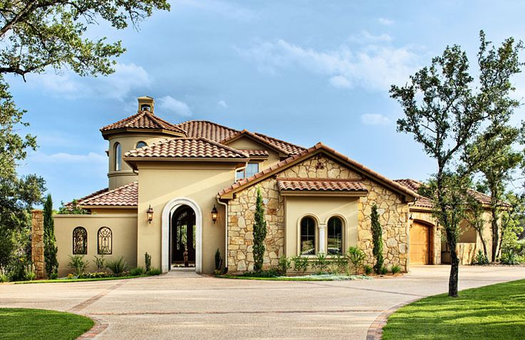 Custom home exterior austin tx mediterranean stone stucco entry gate driveway Custom luxury home design ideas