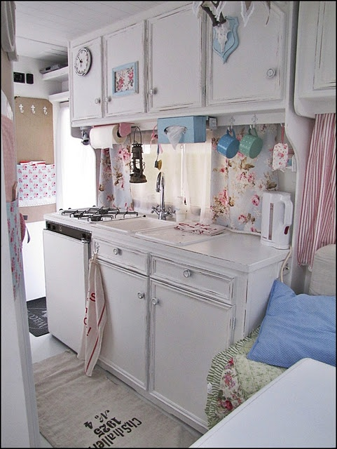 This is sweet! A little foo fooey for me but like the white cupboards