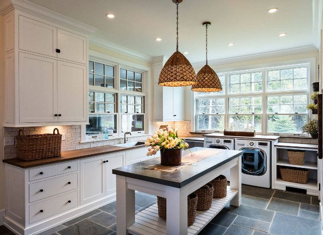 Laundry room with custom folding island, Blustone floor tile and woven pendants. Pendant lights are from Serena and Lily.  Mitch Wise Design, Inc.  Steinberger Photography.e
