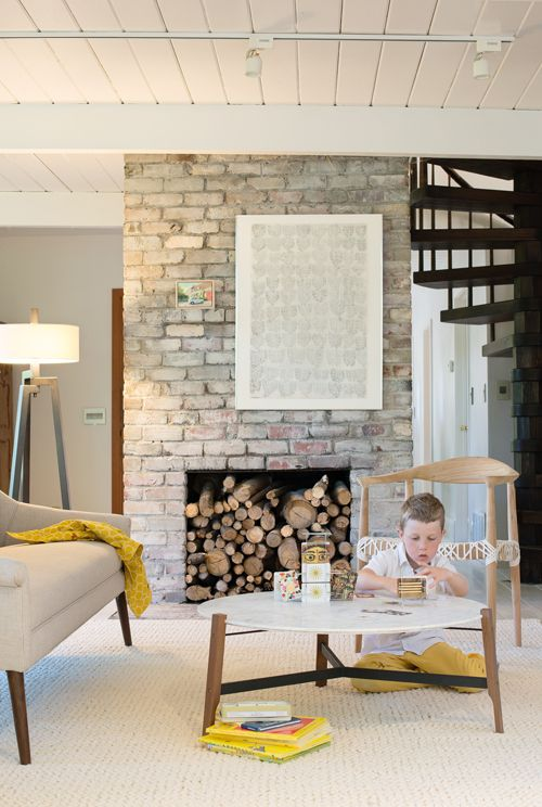 Freestanding White-Washed Brick Fireplace, Off-Centered Art, Spiral Staircase, Tripod Floorlamp, & Neutral Palette