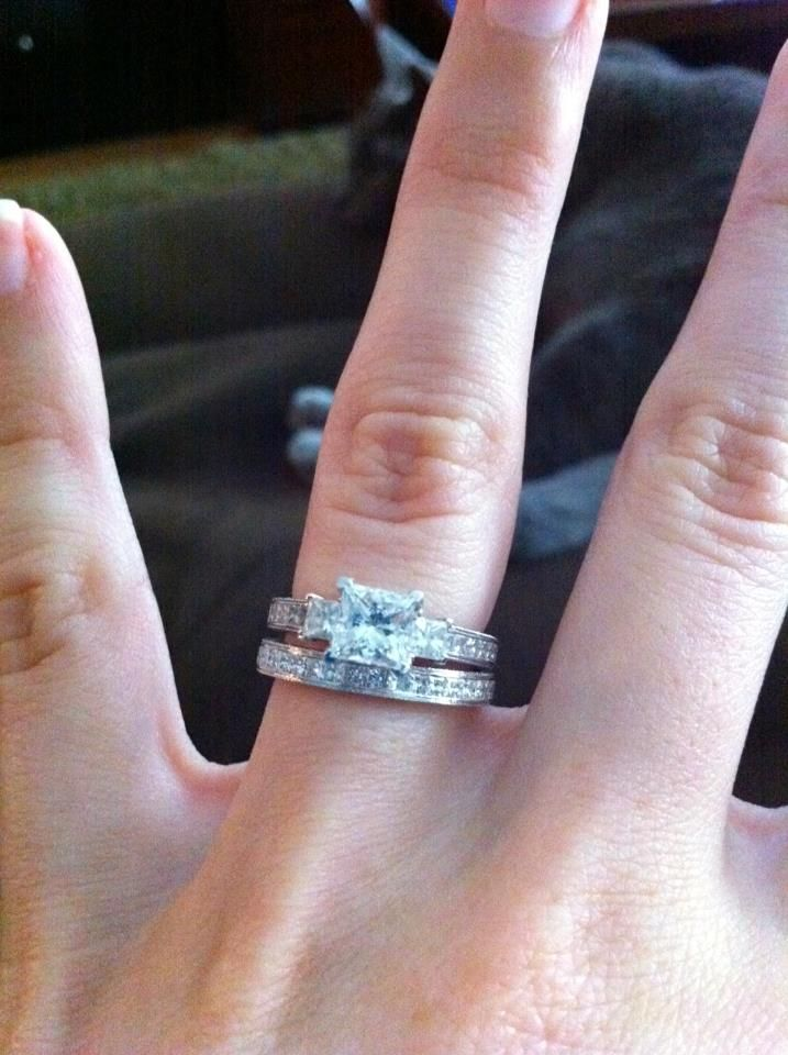 Sent in by a big fan - here's her beautiful engagement ring with matching wedding band, created through our wholesale network. A 1 ct. princess centre with sides and band diamonds to match. The metal used is an 18k white gold and palladium mix. Congratulations!