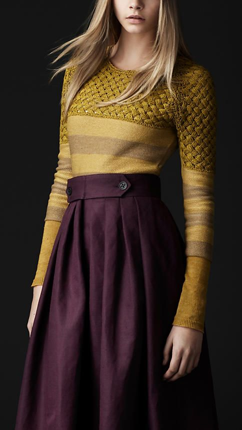 Burberry.  The color combination of mustard yellow and plum is flattering on nearly everyone, light or dark hair, any skin tone.  Accessories: chocolate brown bag and shoes, a pop of color with teal earrings or ring.
