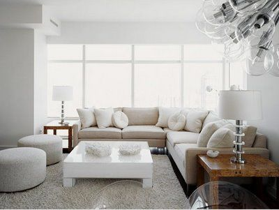 neutral corner sofa | love this! keeps the room open with ottoman seating
