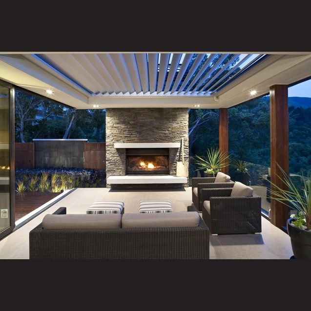 Tall wooden posts carry through to support the veranda roof in the outdoor spaces.