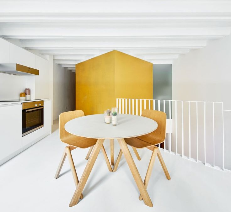 Two old apartments in the heart of Barcelona have been renovated and merged together by inserting cubic volumes in the middle of the space, twisted 45 degrees.