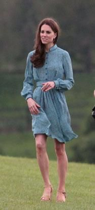 While her husband Prince William rode horseback at a charity polo match May 13, 2012, in Berkshire, England, Duchess of Cambridge Kate Middleton displayed her long athletic legs in a short sea-green dress and high-heeled wedge shoes. (Almasi/Splash News)
