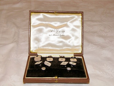 Stunning art deco hallmarked 9 ct white gold and diamond inlaid, collar, tie, and lapel set. i think you may even be able to use them as cufflinks. All the tops have been inlaid with good quality diamonds, we have even had them tested and they are diamonds. Complete with original brown hide case, stamped in gilt is the retailers or manufacters details. A.E Davis Jeweller Ltd 61 a Piccadilly W.I . Total weight of gold is 12.4 grams plus 10 diamonds, only $99 starting bid