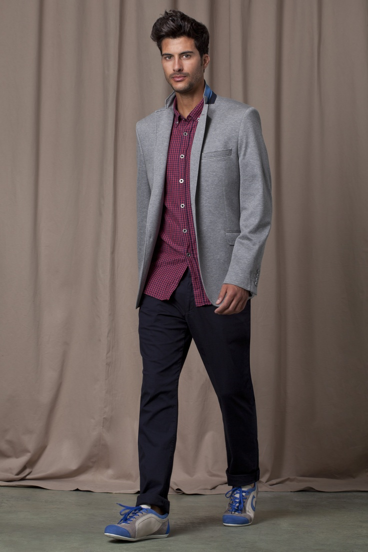 Berry coloured shirt, grey blazer, black trousers with blue and grey training shoes