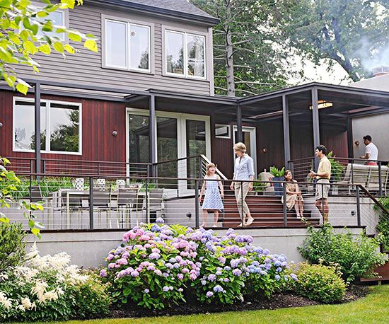 Before, a small 400-square-foot deck encased in solid walls was an abrupt transition to the backyard. Thanks to an open makeover that unified the house, deck, and yard, this contemporary outdoor space became a multipurpose retreat for grilling, gathering, and entertaining.