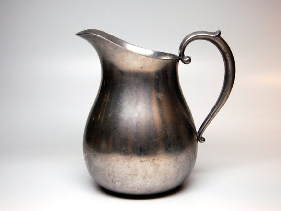 This Preisner Pewter Pitcher  The pitcher measures 6 3/4 inches tall, with a base measuring 3 1/8 inches and the rim measuring 3 1/2 inches rim 16.6 oz wt - holds 39 fl oz.  Its in good condition with no cracks or chips. There are superficial scratches given the age and use of the pitcher.  **VINTAGE DISCLOSURE** Our items are vintage and have had p...
