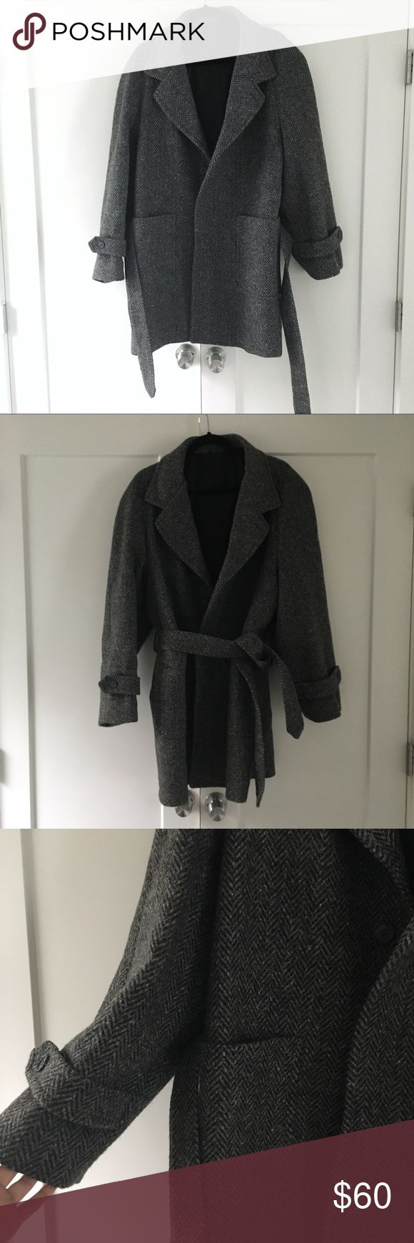 Men's Vintage Herringbone Wool Pea Coat Super cool men's vintage winter wool coat - lined and has waist tie & pockets. Size 40 reg. Will mark it a L. Not sure the exact fiber content but I know it's wool or wool blend with something else. Needs a dry cleaning as it's been in storage but will freshen up nicely. Brand is a vintage 1960's brand! Excellent condition. No trades Vintage Jackets & Coats Pea Coats
