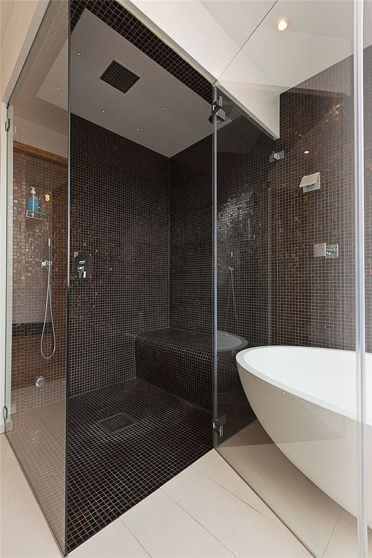 I like this shower and bath,the dark tiles are especially nice.