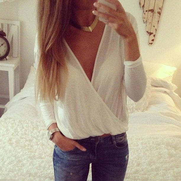 white blouse + gold necklace.
