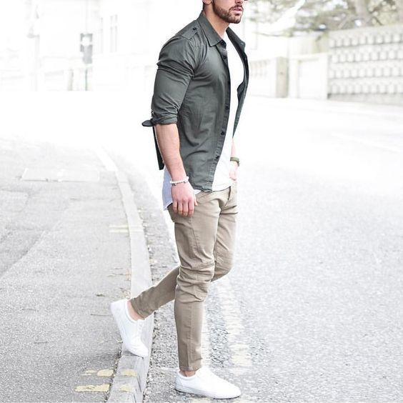 Dress in a grey button-down shirt and nude chinos for a casual level of dress. For footwear go down the casual route with white low top sneakers. Shop this look on Lookastic: lookastic.com/... — Grey Long Sleeve Shirt — White Crew-neck T-shirt — Beige Chinos — White Low Top Sneakers ...repinned vom GentlemanClub viele tolle Pins rund um das Thema Menswear- schauen Sie auch mal im Blog vorbei www.thegentemanclub.de