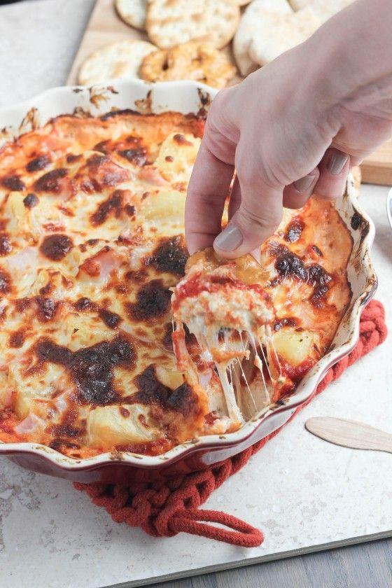 Hawaiian Pizza Dip - 8 ounces room temperature cream cheese, 2 cups mozzarella cheese, 1/2 tsp dried oregano, 1/4 tsp garlic powder, 2 cups pineapple chunks, 6 ounces cubed Canadian bacon, 3/4 cup pizza sauce or marinara