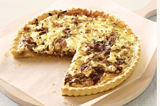 ... cheese is a decadent base for caramelised onion in this classic quiche