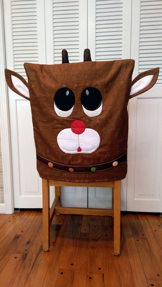 "Reindeer Chair Cover By Ryerson, Annette - 21in x 26in Project Time: 2-6 Hour. Fabric Type: Yardage Friendly. Project Type: Home. Great to use for a Christmas, Holiday or Winter project. CLP patterns are printed on 8-1/2"" x 11"", anti-copy card stock. Because they are customized with your shop's Bill-to account name, phone number and web site, they are not returnable.:"