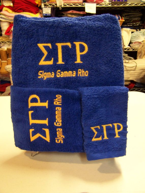 Sigma Gamma Rho Greek Letters embroidered in gold on royal blue towel set. Set consists Bath towel, Hand Towel and Wash Cloth. All 100% Cotton.