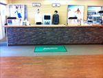 Dry stack stone panels are used at this checkout counter for a sports apparel store.