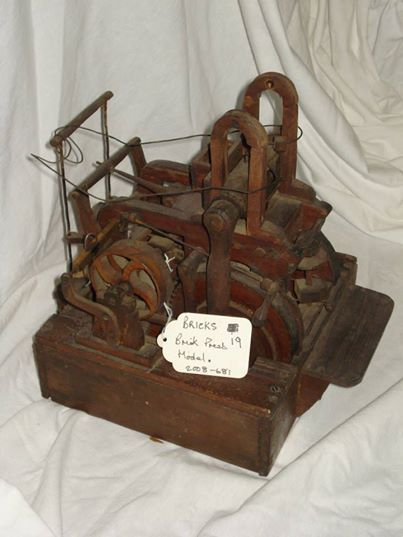 This miniature working brick press was made by Tom Hancock, who was just 14 when he handcrafted the press using old soap boxes and a penknife!
