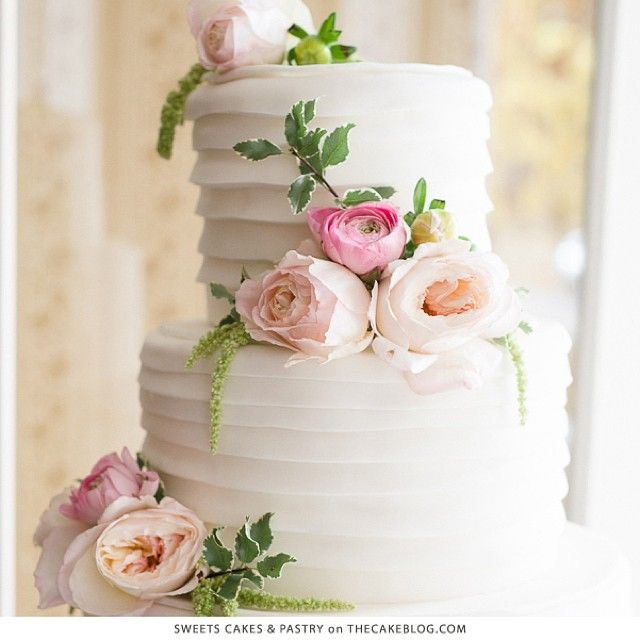 """Loving the preppy pleats and perfectly placed florals in this cake by @sweetswyoming!  It's one of ten springy flower cakes on the blog today!  Hop over…"""